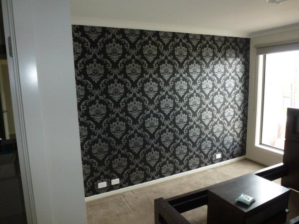 black and silver feature wall in bedroom
